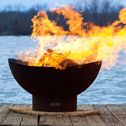 Scallops Wood Burning Firepit - A modern fire feature with a robust bowl for holding lots of burning logs.  The Scallops Firepit can fit into nearly any outdoor decor style. Each one is made to order so you know that you have a one of a kind work of art.