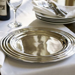 "Chancellor Charger - Beautifully crafted in the understated style of 1940s serving pieces, our Chancellor Charger brings a classically elegant look to the table. 14"" diameter; fits 8"" diameter plate Made of polished stamped aluminum."