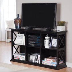 Belham Living - Belham Living Hampton Console TV Stand - Black - DONU105 - Shop for Visual Centers and Stands from Hayneedle.com! You won't see The Hampton Console TV Stand - Black in any of your friends' homes - unless you tell them you found it at Hayneedle. It's a Hayneedle exclusive so you can be sure it's just as original as you are. Two long shelves each feature three cubby compartments providing plenty of room for your DVDs CDs audio-visual components cherished curios and much more. Each compartment has a cord/wire management hole in the back so hooking up and moving electronics is a snap. At 32 inches high the spacious console top will give your TV an extra boost for optimal viewing. Constructed with a solid birch wood frame in a dramatic ebony black finish this TV console has strong durable MDF shelves and compartment dividers in matching black finish. The genuine veneer top also has a black finish for a cohesive contemporary look that will add richness to your decor. The sides of the unit have a modern X design that adds an eye-catching element to the table's sturdy structure. Assembly required. Dimensions Overall dimensions: 55.5W x 14.5D x 32H inches Compartment (each): 17W x 13.125D x 12.31H inches About Belham Living Belham Living builds catalog-quality furniture in traditional styles at a price that actually makes sense. By listening to our customers and working closely with great manufacturers we build beautiful pieces worthy of your home. Rich wood finishes attention to detail and stylish lines that tie everything together are some of the hallmarks of a Belham Living piece. From the living room or bedroom through the kitchen and out onto the deck there's something from an incredible Belham collection perfect for your style.