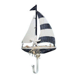 "Wood Sailboat Hanger - The sailboat hanger measures 7.5"" x 12.5"". This item is made of wood and is distressed blue  white in color. It will add a definite nautical touch to whatever room it is placed in and is a must have for those who appreciate high quality nautical decor. It makes a great gift, impressive decoration  will be admired by all those who love the sea."
