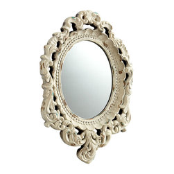 Ornate Illusions Mirror - The interior borders of the Ornate Illusions Mirror include dainty small petals, rows of beading texture, and narrow molding, the accoutrements of a simply-detailed room - while the outer frame is a more fanciful confection in carved scrollwork.  Distressed antique white finish unites the layers of dimensional interest into a timeless combination of ornaments.