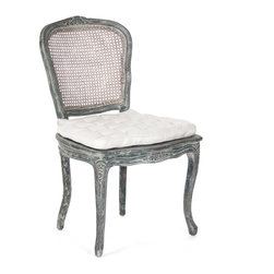 Kathy Kuo Home - Caned Back French Country Annette Dining Chair - Antique Black - An intricately designed chair for the dining room, this piece, inspired by the French country style is carved from birch and features a caned back for a less formal look. The tufted seat cushion adds comfort and complements the elaborate carvings in the legs and seat frame.