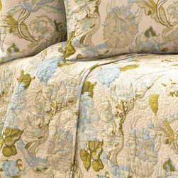 Dusty Floral Blue Quilt - Small-scale, subtle trapunto quilting gives dimension and prominence to a foreground of flowers in the Dusty Floral Blue Quilt, an elegant coverlet with antique inspirations.  In a glamorous, timeless palette of delicate blue, leaf green, and vintage ivory, the quilt evokes the romance and comfort of the past while lending fresh drama to a room with its large-scale pattern and on-trend colorway.