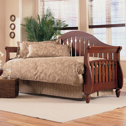 """Fashion Bed Group - Fraser Daybed With Link Spring in Walnut Finish Finish - The design of the Fraser daybed is simplicity itself. The back has a curved camel back and the arms curve out, as if inviting you inside. The back and arms comprised of 3?"""" wood slats set one inch apart with a keyhole pattern carved in the center slats of the back and all the slats of the arms. The front of the arms bow out at the bottom and end in delicately carved feet. The Fraser is made of Poplar wood and comes in two finishes, Walnut and Frost (white). It is a really versatile piece of furniture to go with many decors, suitable for both seating and sleeping."""