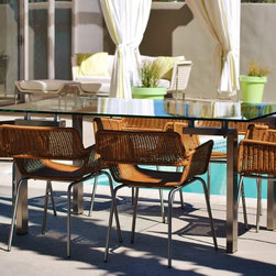 outside/in modern outdoor furniture - outside/in deepwell rectangular dining table (stainless steel, tempered glass) with deepwell synthetic rattan dining chairs (stainless steel frame)
