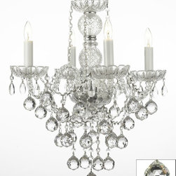 "The Gallery - Authentic All Crystal Chandelier W/ 40Mm Crystal Balls H22"" X W17"" - THIS MAGNIFICENT CHANDELIER IS DRESSED WITH 100% CRYSTAL. Nothing is quite as elegant as the fine crystal chandeliers that gave sparkle to brilliant evenings at palaces and manor houses across Europe. This beautiful chandelier is decorated with 100% crystal that capture and reflect the light of the candle bulbs, each resting in a scalloped bobache. The crystal glass arms of this wonderful chandelier give it a look of timeless elegance that is sure to lend a special atmosphere in any home. This chandelier is dressed with spectacular crystal balls which take the sparkle to an entirely new level of brilliance! Assembly Required. H22"" W17"" 4 LIGHTS"
