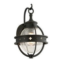 Troy Lighting - Mendocino Outdoor Wall Sconce by Troy Lighting - With antique styling and rich finishes, the Troy Lighting Mendocino Outdoor Wall Sconce offers a warm welcome on a foggy night. Hand-worked iron creates a cage around a Clear Seeded glass globe. Surrounding the cage, a metal cuff is embellished with punched circles and quatrefoils, and the wall plate features a decorative hook for an authentic lantern look. Troy Lighting, headquartered in California, designs and manufactures indoor and outdoor lighting fixtures, utilizing hand-forged iron and hand-applied finishes to create quality products with high-style appeal.