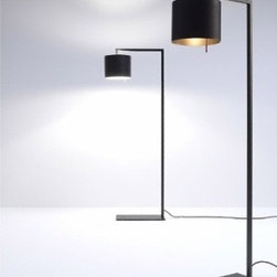 """Anta - Afra floor lamp - Catalog Featured - Product Description:  The Afra floor lamp by the German manufacturer Anta is an elegant reading lamp. The base fits perfectly beneath a chair or a sofa. All Elements are made of steel manufactured in matt black color while the inside of the bellied lampshade is held in gold or silver. Afra donates a very soft light and is by its very subtle form a very decorative interior piece.                                 Manufacturer:               Anta                                  Designer:                             Anta                                                Made in:              Germany                                  Dimensions:                             Projection: 20.5"""" (52cm)x height:55"""" (140 cm)                                                Light bulb:                             1 x max. 100W incandescent                                                Material:               metal"""