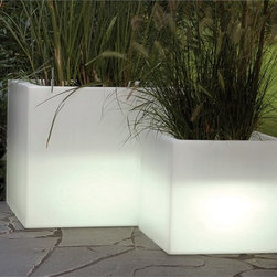 Cubotti Planters Illuminated by Serralunga - Cubotti Planters Illuminated by Serralunga. Furnishing accessory for contemporary settings. Cubic pot, basic shape with micro- dotted surface, suitable for decorating modern and refined locations. This pot is lifted slightly from the ground and can be used for direct potting (as a cachepot) or for hydroponics. Available also a size with a slender shape. This vase is available with RGB LED lighting sistem. Cubotti Planters Illuminated by Serralunga are designed by Nat Wave.
