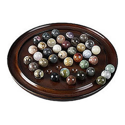 """Solitaire Game - The Solitaire Game Measures 9.75"""" x 1.5"""". The gameboard is made of hand turned mahogany. It comes with 36 unique semi-precious marbles with two spares. No two marbles are alike. This game is fun, decorative, educational and colorful. It comes gift packaged."""