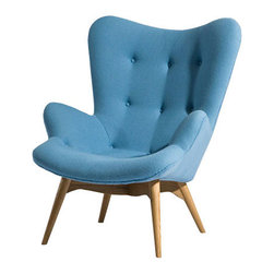Paddington Lounge Chair in Sky Blue - Sit around, stylishly, with the Paddington Lounge Chair. Form and comfort meet in the mid-century modern design and luxurious styling. Upholstered in wool and supported by solid white oak wood legs, this armchair makes for a cozy sitting experience in any space.