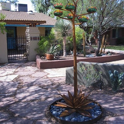 Steel Agave Sculpture - All steel agave with blown glass bulbs and LED lighting.