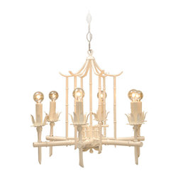 White Pagoda Chandelier - Subtle but original, this white pagoda chandelier would blend in well in a light room for a discrete statement, or it would stand out in a bright, colorful room.