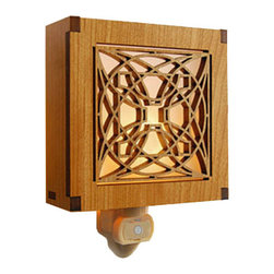 "Lightwave Laser - Frank Lloyd Wright Luxfer Prism Night Light - The design source for this Frank Lloyd Wright Night Light is one of a series of patented designs for the glass prisms created by Frank Lloyd Wright for the American Luxfer Prism Company. This design is based on a flower composed of circles and squares. This stunning new Frank Lloyd Wright Luxfer Prism design hardwood night light is precision laser cut for quality of finish and design accuracy. The night light has a built in light sensor to automatically turn on and off. Complete with a 7 watt night light bulb. Size: 3.87"" x 3.87"""
