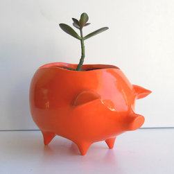 Ceramic Pig Planter Vintage Design, Orange By Fruit Fly Pie - I own this hand-glazed little piggie planter in bright yellow. Mine is tucked in my workspace with a fuss-free succulent planted inside. It always makes me smile.