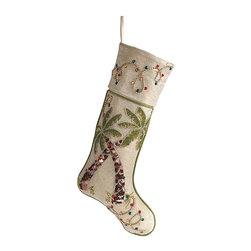 """Frontgate - Holiday Palm Trees Christmas Stocking - From designer Kim Seybert. Hand-applied multicolored beads. Lurex adds festive sparkle to the cotton. Skirt is finished with piping on the edges and a covered button closure. Spot clean. Wherever you spend the holidays, say """"Mele Kalikimaka"""" with our Holiday Palm Trees Stocking. A hand-beaded design over breezy linen-hued cotton lurex communicates the undeniable, relaxed appeal of palm trees wrapped in Christmas lights.  .  .  .  .  . Imported."""