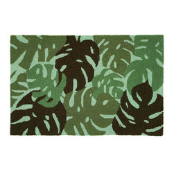 Homefires - Tropical Leaves - Green Rug - A luau awaits the minute you feel this wool-like area rug under your feet. The grass skirts rustle in the ocean breeze while you smell the sweet scent of barbecue. Luckily it's machine washable just in case you spill your Mai Tai.