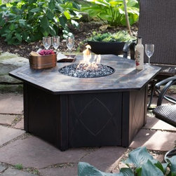 UniFlame 55-in. LP Gas Outdoor Fire Pit Table with Decorative Slate Tile - Let the UniFlame 55-in. LP Gas Outdoor Fire Pit Table with Decorative Slate Tile anchor your patio and watch the crowds gather. With a large six-sided tile tabletop and decorated panel steel base that hides its inner workings it's a graceful way to heat things up. Open the access door and slide out the 20 lb. LP tank with it's convenient tank drawer. It puts out up to 30 000 BTUs through a stainless steel burner in the bottom of the firebowl covered with elegant fire rock for a look that's sure to spark a conversation or two. Comes with a protective fire pit cover. About Blue Rhino/Uniflame/Endless Summer:Blue Rhino Global Sourcing Inc. is America's #1 propane tank exchange brand but it doesn't stop there. Blue Rhino is a leading designer and marketer of outdoor appliances and fireplace furnishings. These products include barbecue grills outdoor heaters outdoor fireplaces mosquito traps and fireplace furnishings. You'll find a Blue Rhino product in the middle of half a billion barbecue events nationwide every year. They come under various brand names including UniFlame Endless Summer and SkeeterVac.