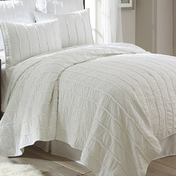 Levtex Home - White Ruffle Quilt Set - This beautiful white set adds a luxurious touch to bedroom décor. Layered ruffles and ultra-soft fabric create the perfect haven for rest and relaxation.   Includes quilt only Shams: 26'' W x 20'' H 100% cotton Machine wash Imported