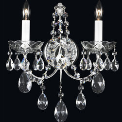 Schonbek - Madison Silver Two-Light Clear Heritage Handcut Crystal Wall Sconce, 12W x 14.5H - -Heritage Handcut Crystal: This crystal is cut by hand in two stages on an iron and then a sandstone wheel. Each crystal is then polished on a wood wheel with marble dust. The most authentic handcrafted crystal in the world.  - Modeled in the grand tradition of crystal lighting, Madison reflects the balanced proportion of the iconic crystal luminaire. This heirloom-quality piece is elegantly adorned with Heritage Handout crystal trim, completing the classic design.  -Clear Heritage Handcut  - Light Source: Incandescent Bulb  - Bulbs not included  - Uses standard line volt dimmer  - Some assembly required  - For shipping outside of USA, please contact Bellacor customer service  - Cleaning and Care Instructions: Every Schonbek product is of heirloom quality and will last for generations. To ensure it retains its brilliance and splendor for years to come, proper care and regular cleaning are necessary. It is recommended that Schonbek products, and particularly their crystal trim, be lightly dusted with a feather or lambswool duster, or soft brush every two months, or whenever it appears dull or dusty. Consult the fixtures trim diagram for detailed cleaning instructions list of approved cleaning solutions. Schonbeck fixtures should never be subjected to any chemical cleaning agents. - See packaging insert for warranty information. Schonbek  - 1586-40H