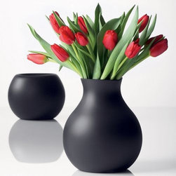 Menu - Rubber Vase by Menu - The Menu Rubber Vase, designed by Henriette Melchiorsen, is a fantastically unique vase that can be molded into various shapes to suit your decor. The Rubber Vase, as its name implies, is made from rubber and is a friendly option when there are small children around. Amazingly stylish in Black or Red and completely funky in Lime Green.  The small size has been discontinued, limited quantities available.