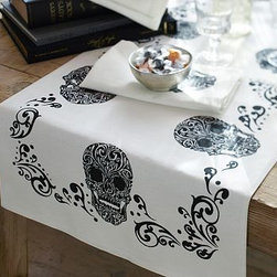 """Day of the Dead Skull Table Runner, 16 x 108"""" - Skillful replicas of the classic Mexican Calavera Catrinas, or elegant skulls, are rendered on our table runner. 18 x 108"""" Woven of a linen/cotton blend. Backed with cotton. Machine wash. Imported. Catalog / Internet only."""