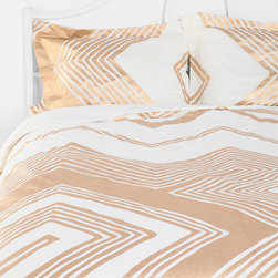 Magical Thinking Geo Empire Duvet Cover - This white cotton duvet is topped with a vibrant zigzag design in gold metallic ink. It's perfect for cuddling up with on cold winter nights.
