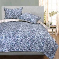 Impressions Cotton Moroccan Paisley Quilt Set - The intricate details of the Impressions Cotton Moroccan Paisley Quilt Set will transform your bedroom into a Moroccan oasis. The soothing blue-gray paisley is accented on the opposite side with a complementary pattern. This quilt set is made from soft and durable 100% machine-washable cotton and is available in your choice of size. The Full/Queen set includes a quilt and two standard-size pillow shams (one standard pillow sham with the Twin set). The King set includes a quilt and two king-size pillow shams. Dimensions Twin: 86L x 68W in. Full/Queen: 92L x 88W in. King: 106L x 92W in. Standard pillow sham: 20L x 26W in. King pillow Sham: 20L x 36W in. About Home City Inc.Established in the 1980s in Queens, New York selling towels and lower-thread-count sheets, Home City Inc. started in small office and has developed into a worldwide manufacturing and importing company based out of Brooklyn, NY. They were able to establish the name Home City Inc. in 2003 which set the tone for the growth in a company that boasts over 25 years of experience in production. Over the years Home City has developed and perfected unparalleled quality products that now serve domestic and international retail stores. Today, Home City's fulfillment center is located in Linden, NJ with a showroom on Fifth Avenue in New York, NY, allowing them to provide their customers with an expanded selection of sheet sets, duvet cover sets, bed skirts, pillowcase sets, bed-in-bag sets, down comforters, mattress toppers, pillows, quilts, robes, towel sets, and more.