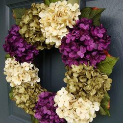 All Seasons Hydrangea Wreath by HomeHearthGarden - Hydrangea flower quick fact: Hydrangea flowers appear in a wide variety of colors. The Ph level and aluminum content of the soil influences the final color of the flower.