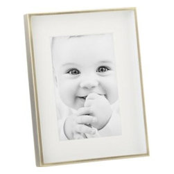 Sienna 4x6 Frame - Classic look to compliment a treasured photo, in a deep-set white mat, bordered in the warm glow of a brushed-brass finish. Great on a shelf, side table, desk or mantle, and makes a failsafe gift. Frame stands horizontal or vertical with an acid-free mat to the life of the featured photograph.