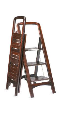 "Grandin Road - Wooden Step Stool - Crafted from solid wood. Steel-reinforced steps. Safety rail adds comfort. Oversized platform locks into place for added security. Rich mahogany finish. Forget flimsy plastic and step up to this high-quality Wooden Step Stool. This step ladder is ready at a moment's notice for lending a helping hand, then folds neatly away in a 2-1/2""-deep space. . . . . . Folds flat for easy storage. 225-lb. weight capacity."