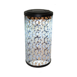 Smart Solar - Frosted Fretwork Cylinder Solar Lantern - Casts a fretwork pattern on any surface. Decorative lighting ideal for tabletops on your deck, patio or in your garden. Galvanized steel lantern with frosted glass effect. On/Off switch to control light. Automatically illuminates at dusk and turns off at dawn. Powered by an integral solar panel. Energy saving white LED. Up to 8 hours of light when fully charged. Sits on flat surfaces, or can be staked into the ground. Replaceable, rechargeable Ni-MH battery. No wiring, simply install and enjoy. No operating costs.