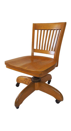 Solid Oak Swivel Chair - This swivel desk chair is made out of solid oak. It has some markings under the seat but no manufacturing company tags. The chair is in great condition with a few scratches due to normal use and aging. It has beautiful grain that is accentuated by the carved seat detail.