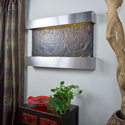 """Bluworld Innovations, LLC - Horizon Falls Medium Fountain 24.5""""H x 37.5""""W Brushed Stainless Steel - Created around the popular Nojoqui Falls series but in a horizontal orientation. This series combines genuine multi-color Indian Rajah Slate with water flowing passed polished river rock creating a soothing sound and awesome focal point for any room. Now shipping with LED Lights!!! Choose and change colors to your mood from cool white plus 12 additional colors. Create effects such as gradual transition of colors, dim, brighten, and more all with remote control keypad. Rated for over 20,000 hours of lighting. Engineered with Bluworld's splash-free design and featuring the new NSI Slate, this water feature arrives to you completely assembled; simply hang on the wall per instructions and finish with the trim kit of your choice. Trim kits are available with a Copper Patina, Brushed Stainless Steel, Coppervein powder coat, or Black Onyx powder coat frame. NSI Slate- Our special process shears a layer of genuine Indian Raja Slate and fuses it to a composite material with the same chipped edge technique as slab slate. They are indistinguishable from a thick slab of slate. All the beauty is retained and the weight is reduced by over 90%. Please note that these units are handmade and measurements may vary slightly. Texture and color of the copper and slate may also vary slightly with each fountain."""