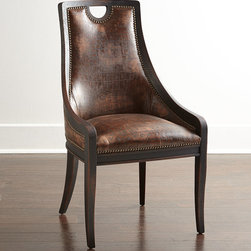 """Old Hickory Tannery - Cinda Leather Dining Chair - BROWN - Old Hickory TanneryCinda Leather Dining ChairDetailsEXCLUSIVELY OURS.Maple frame.Top-grain leather upholstery.Nailhead trim.Finished back.22""""W x 26""""D x 40""""T; seat 19.5""""W x 18""""D x 19""""T.Made in the USA.Boxed weight approximately 55 lbs. Please note that this item may require additional shipping charges.Designer About Old Hickory TanneryFounded more than 30 years ago Old Hickory Tannery is still family owned and operated in Hickory North Carolina. Although the company's name reflects its original focus on fine leather upholstery Old Hickory is now equally well know for fabric-covered seating. Its range of styles is impressive from dramatic Duncan-Phyfe-style sofas to graceful Queen Anne armchairs claw-footed tub chairs feminine full-skirted settees and sleek slipper chairs. Old Hickory's craftsmen bring an abundance of expertise to their work; some have been making furniture for almost half a century. All upholstery is cut and sewn entirely by hand all frames are solid hardwood nailhead trim is hand-hammered and all springs are hand-tied to the frame and surrounding springs at eight points for lasting comfort and stability. These are just a few of the reasons why this American furniture maker is one of our favorites."""