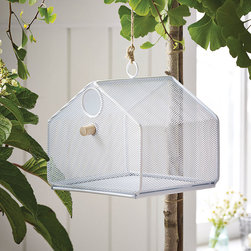 Hanging Around Mesh Birdhouse - This one's for the birds--literally. Gorgeous in its minimalism, your feathered neighbors will love calling this mesh birdhouse home. And because its bottom slides out, you'll love how easy it is to clean.