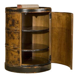 Uttermost Lawton Storage Drum Table - Solid, plantation-grown mango wood finished by hand in dark cinnamon with black rubbed edges. Hinged door with two adjustable shelves. Solid, plantation-grown mango wood finished by hand in dark cinnamon with black rubbed edges. Hinged door with two adjustable shelves.