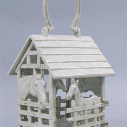 AA Importing - Cast Iron Corral Candle Holder in White Finis - Ideal for the horsey set, this marvelous cast iron candle holder is not just for cowboys.  The clever design features a four-sided corral complete with slat A-frame roof and a clever horseshoe shaped hanger.  Meticulously crafted from cast iron, it features a white painted finish that will resist rust.  Incredibly detailed featuring two adult horses and two colts, it will hold a pillar candle and will emit a warm, alluring glow when lit.  This makes a great gift for any equestrian buff. Cast iron with White painted finish. Corral design. Holds candle up to 3 in. Dia.. 7 in. L x 6.5 in. W x 9 in. H