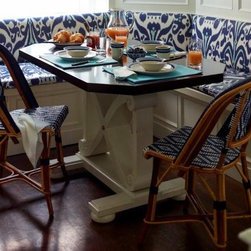 Custom Designed Furniture - The design for this breakfast area table was inspired by an antique trestle style piece found in pantry areas of English manor homes.  The base has bun feet and the top is a dark stained walnut.  The design was a collaboration with interior designer Ashley Whitakker.