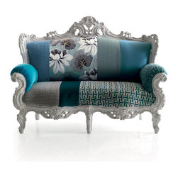 "Relax Prince 2 Seater Sofa - Relax Prince sofa from Moda is a two seater baroque inspired designer sofa. This stylish sofa will make a glamorous addition to your living room or the home library. Taking inspiration from french style, but adding that essential Italian twist, this designer lounge sofa can be finished in the latest vintage finishes from light (as shown) to natural to black. Vintage finish is the latest trend in Milan giving new furniture that ""worn in"" look. This designer sofa can be upholstered in a variety of fabrics and patchwork patterns. Shown is Patchwork Ocean mood. Also available in Patchwork Hills and Patchwork Desert."