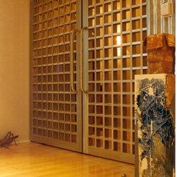 Grand Entry Doors - Beautiful award winning bronze entry door in a Florida home.