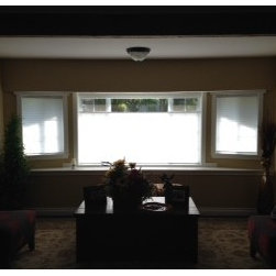 Cellular Shades - Beautiful white cell shades were chosen for this Puyallup, WA sitting room. Adding the top down bottom up feature is a nice touch!