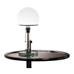 Matrix International - Wagenfeld Table Lamp - High quality Italian reproduction of the table lamp designed by Wilhelm Wagenfeld (or CJ Jucker depending on whom you ask) while at the Bauhaus in 1924. The shade is blown white opaline glass, the base and stem are constructed of cut glass with chrome fittings. 60W incandescent bulb not included. Not UL Listed.