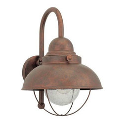 Sea Gull Lighting - Sebring Outdoor Weathered Copper Wall Mount - This eye catching outdoor wall mount is crafted from aluminum. It displays a weathered copper finish and clear seeded glass that adds just the right sparkle. Please note that the height from the center of the outlet box is 9?. Sea Gull Lighting - 8871-44