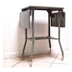 Vintage Typewriter Stand by Vintage Finds from Alexandra Keller - I love vintage carts and tables. This is old typewriter stand is fabulous! It would work great as a console table for some instant old school vibe.