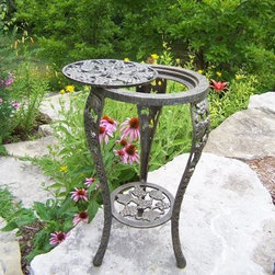 Oakland Living Grape Table & Stand - Antique Pewter - The Grape Table & Stand - Antique Pewter has a timeless appeal that'll add to the elegance of your surroundings by displaying your favorite plants and blooms in style. Intricately designed with grape and vine motifs this stand is sturdy enough to accommodate even larger arrangements.Made of durable cast iron this plant stand is strong and durable even in heavy winds yet relatively lightweight making it easy to move. The high-grade polyester powder coat Antique Pewter finish is designed to maintain its appearance for years to come with minimal maintenance. A wonderful addition to any discerning home this lovely plant stand is sure to attract the admiration of your guests. Comes with brass and stainless steel assembly hardware and assembly instructions.