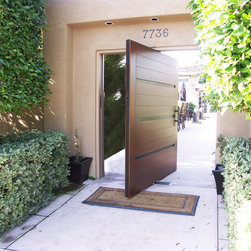 Access front entry pivot door - This pivot door is a great alternative to a traditional front entry door.  The channels add great character in the door.