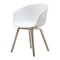 "About A Chair - ""Conspicuous simplicity"" is how Hee Welling characterizes the About A Chair, among a series of well-priced, quality chairs that he designed for Hay Denmark. Add ""versatility"" to the list. It fits perfectly around any table—dining or conference. Or try it behind a desk. The curved polypropylene shell makes this a comfortable place to take a load off. The beech legs are veneered in soap-treated oak or black-stained ash. As a group or alone, it's all about the chair…"