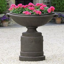 Campania International - Campania International Medici Planter with Pedestal - PPD-630-AL - Shop for Planters and Pottery from Hayneedle.com! Gracefully designed to elevate your landscape design the Campania International Medici Planter with Pedestal features a wide basin scrolled handles and a coordinating round pedestal base. A stunning showcase for your flowers this set comes in a wide variety of aged finish options. Both are made of lightweight and durable cast stone to beautifully withstand the elements. Campania Cast Stone: The ProcessThe creation of Campania's cast stone pieces begins and ends by hand. From the creation of an original design making of a mold pouring the cast stone application of the patina to the final packing of an order the process is both technical and artistic. As many as 30 pairs of hands are involved in the creation of each Campania piece in a labor intensive 15 step process.The process begins either with the creation of an original copyrighted design by Campania's artisans or an antique original. Antique originals will often require some restoration work which is also done in-house by expert craftsmen. Campania's mold making department will then begin a multi-step process to create a production mold which will properly replicate the detail and texture of the original piece. Depending on its size and complexity a mold can take as long as three months to complete. Campania creates in excess of 700 molds per year.After a mold is completed it is moved to the production area where a team individually hand pours the liquid cast stone mixture into the mold and employs special techniques to remove air bubbles. Campania carefully monitors the PSI of every piece. PSI (pounds per square inch) measures the strength of every piece to ensure durability. The PSI of Campania pieces is currently engineered at approximately 7500 for optimum strength. Each piece is air-dried and then de-molded by hand. After an internal quality check pieces are sent to a finishing department where seams are ground and any air holes caused by the pouring process are filled and smoothed. Pieces are then placed on a pallet for stocking in the warehouse.All Campania pieces are produced and stocked in natural cast stone. When a customer's order is placed pieces are pulled and unless a piece is requested in natural cast stone it is finished in a unique patinas. All patinas are applied by hand in a multi-step process; some patinas require three separate color applications. A finisher's skill in applying the patina and wiping away any excess to highlight detail requires not only technical skill but also true artistic sensibility. Every Campania piece becomes a unique and original work of garden art as a result.After the patina is dry the piece is then quality inspected. All pieces of a customer's order are batched and checked for completeness. A two-person packing team will then pack the order by hand into gaylord boxes on pallets. The packing material used is excelsior a natural wood product that has no chemical additives and may be recycled as display material repacking customer orders mulch or even bedding for animals. This exhaustive process ensures that Campania will remain a popular and beloved choice when it comes to garden decor.About Campania InternationalEstablished in 1984 Campania International's reputation has been built on quality original products and service. Originally selling terra cotta planters Campania soon began to research and develop the design and manufacture of cast stone garden planters and ornaments. Campania is also an importer and wholesaler of garden products including polyethylene terra cotta glazed pottery cast iron and fiberglass planters as well as classic garden structures fountains and cast resin statuary.