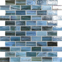 "Glass Tile Oasis - Oceanic 1"" x 2"" Blue Pool  Glossy & Iridescent Glass - Sheet size:  1.02 Sq. Ft.   Tile Size:  1"" x 2""   Tiles per sheet:  66    Tile thickness:  1/4""   Grout Joints:  1/8""   Recycled Components:  70%   Sheet Mount:  Paper Face     Sold by the sheet    - This collection is evocative of the glass-like natural layered silica created by volcanic stone formations. With a nod to old world Venetian glassmakers  our mosaics are created using the same processes from molten silica; hand-poured  blending transparent and opaque colors and natural and opalescent finishes into a unique  luxurious glass designed to please the most discriminating eye. It is available in 14 dramatic color blends and two finishes  Glossy & Frosted. Each piece is hand-poured and unique  designed with a certain amount of variation and variegation of color  tone  texture and shade for a distinctive appearance. Our hand-made process incorporates creases  wrinkles  waves  bubbles and other surface effects indicative of hand-made glass  all designed to capture light and enhance the final beauty of the project."